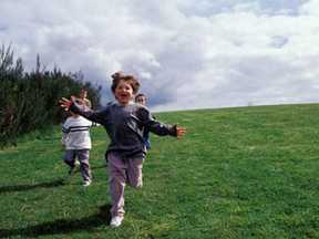 Kids running on a field of grass